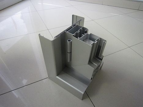 Section of internal door with aluminum wall edgings